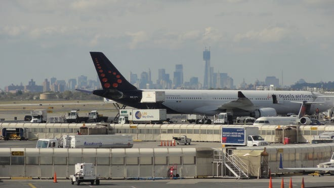 The New York City skyline can be seen behind as a Brussels Airlines Airbus A330-300 jet is serviced at New York JFK (John F. Kennedy) International Airport on Oct. 18, 2012.