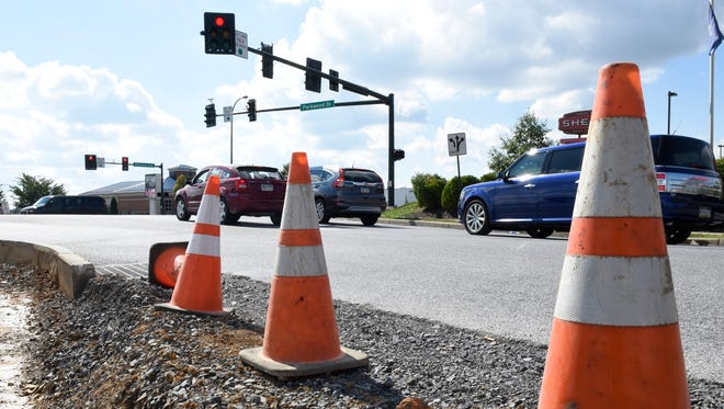 Cones mark a section on Monday, Oct. 3, 2016 where sidewalk work is being done near the intersection of Parkwood Drive and Norland Avenue, Chambersburg, Plans are in the works to extend Parkwood Drive from Norland Avenue to Grandpoint Road.