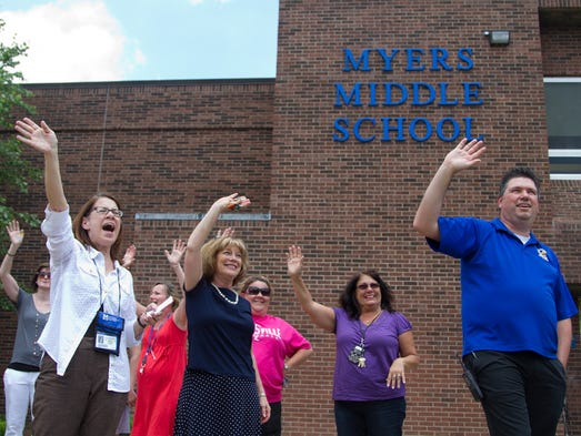 Myers Middle School teachers wave goodbye to students as their busses depart on their last day of school. June 6, 2014.