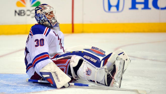 New York Rangers goalie Henrik Lundqvist sits on the ice in disbelief after Dwight King's third-period goal.