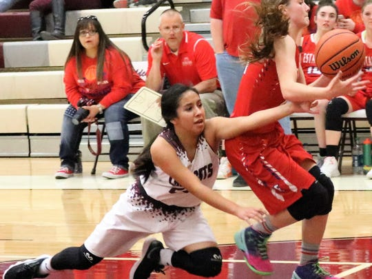 Tularosa's Brynn Martinez, left, fights for possession