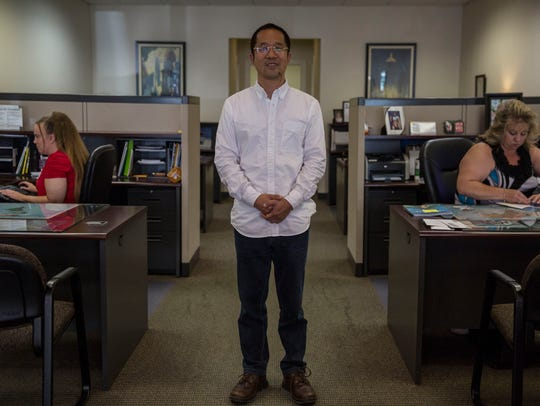 Glad Cheng, a businessman from Beijing, stands in the
