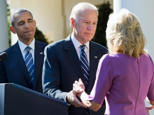 President Barack Obama watches as Vice President Joe Biden turns to his wife Dr. Jill Biden after announcing that he will not run for the presidential nomination, Wednesday, Oct. 21, 2015, in the Rose Garden of the White House in Washington.