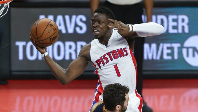 Pistons guard Reggie Jackson scores against Cavaliers forward Kevin Love during the third quarter of the Pistons' Game 4 playoff loss at the Palace on April 24, 2016.
