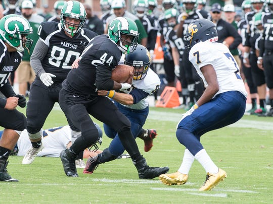 Parkside's Nayel Oge (44) maneuvers around Kent County's defense during a game at Wicomico County Stadium on Saturday, Sept. 2, 2017.
