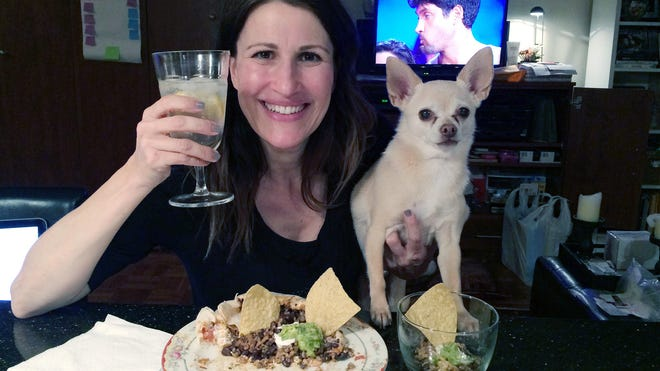 Joanie Pelzer poses with her dog Hubbell, a 9-year-old Chihuahua. When Pelzer signed up with a dog-friendly online dating service a few years ago, she was honest about her Chihuahua: He likes people more than other dogs, craves attention, steals food and can't stand to ride in the backseat of a car.
