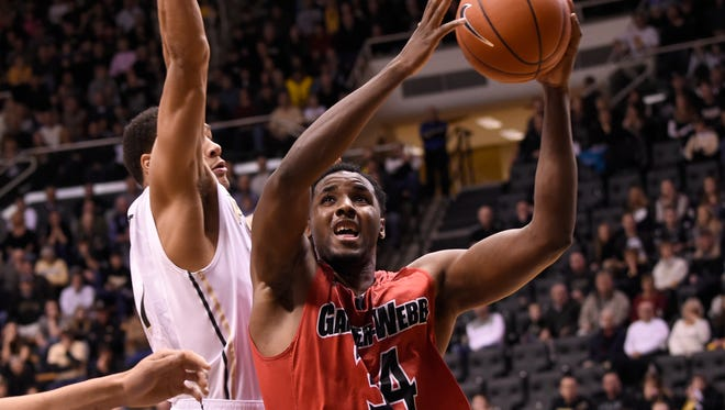 Dec 22, 2014; West Lafayette, IN, USA;  Gardner Webb Runnin Bulldogs forward Jerome Hill (34) drives past Purdue Boilermakers guard Bryson Scott (1) in the first half at Mackey Arena. Mandatory Credit: Sandra Dukes-USA TODAY Sports
