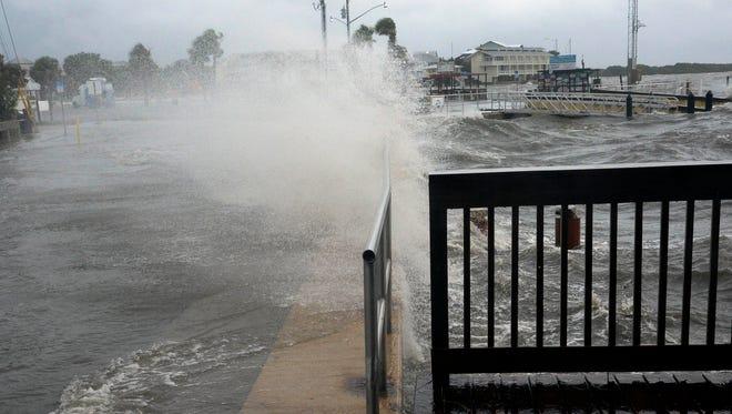 The Gulf of Mexico breaks over the seawall in Cedar Key, FL.