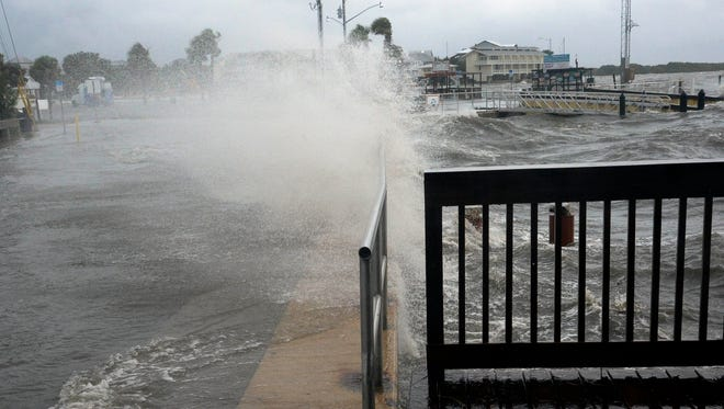 Waves smash a seawall in Cedar Key, Fla. as Hurricane Hermine makes it way towards the state of Florida.