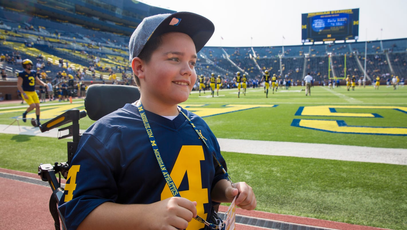Once paralyzed, boy, 11, walks end zone to end zone at Big House