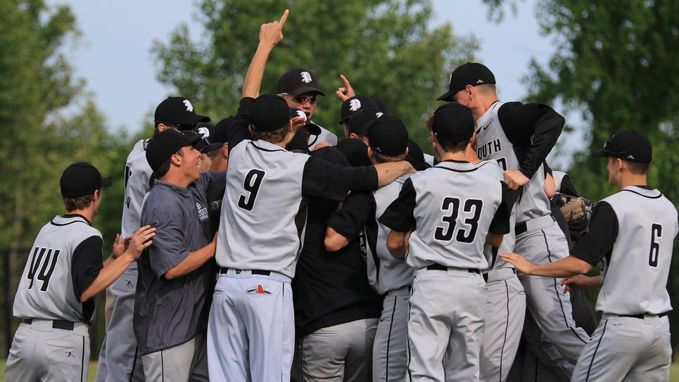 Plymouth baseball players mob each other after winning