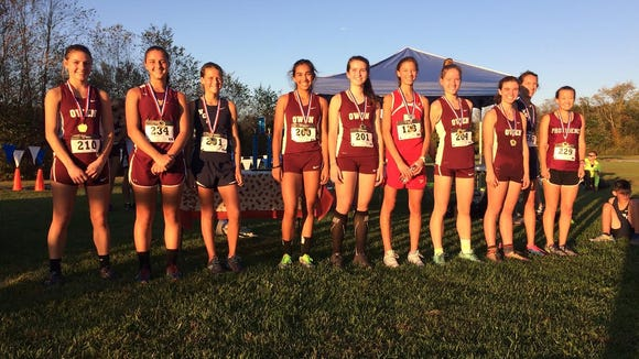 Top-10 girls runners at Thursday's Veritas Christian Academy Invitational cross country meet in Fletcher.