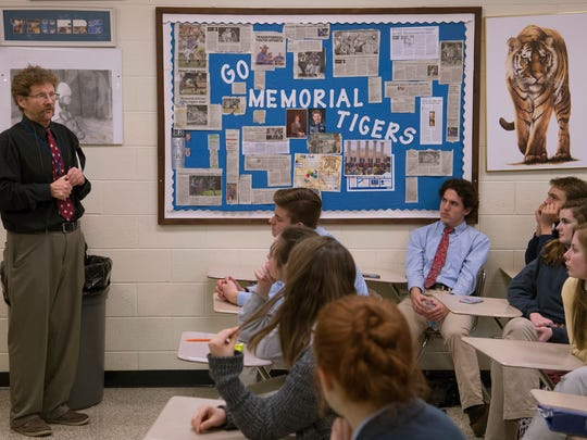 Memorial High school teacher Larry Mattingly leads a discussion on the Nazis and World War II with his history class Monday afternoon. Mattingly has taught for 32 years at the school and also serves as the varsity wrestling coach.