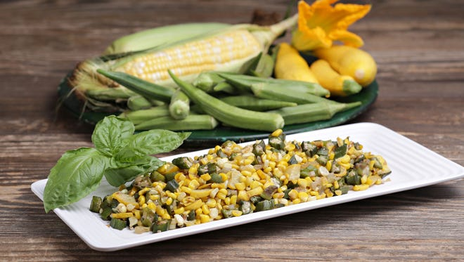Freshly picked sweet corn, yellow squash and okra from McClendon's Select farms, comprise the ingredients to Marsha McClendon's stir fry. as seen in Peoria on Sept. 29, 2014.