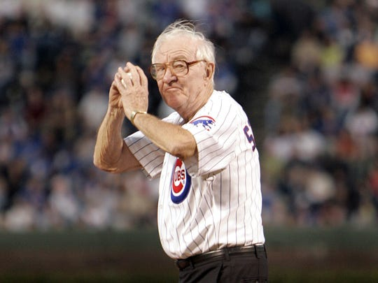 FILE - In this Sept. 14, 2005, file photo, U.S. Supreme Court Justice John Paul Stevens winds up to throw out the first pitch before the start of the Chicago Cubs game with the Cincinnati Reds,  at Wrigley Field in Chicago. John Paul Stevens has rooted for the Chicago Cubs his whole life. And in this case, that's really something. How many fans can say they went to the very first World Series game at Wrigley Field? (AP Photo/Jeff Roberson, File)