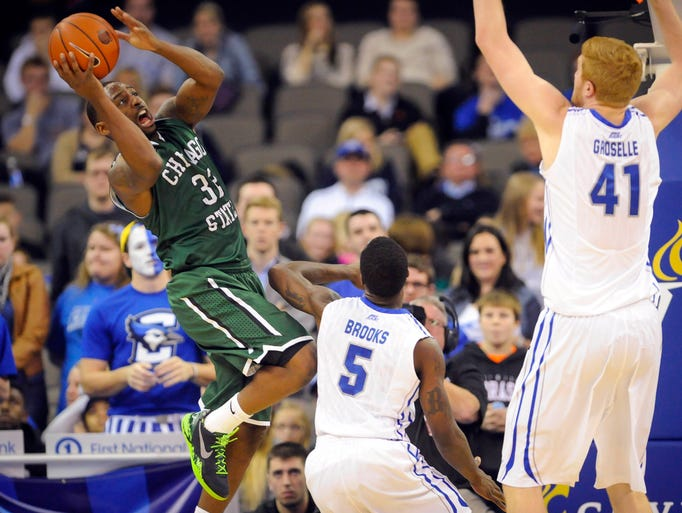 Chicago State guard Nate Duhon takes a shot over Creighton guard Devin Brooks and center Geoffrey Groselle at the CenturyLink Center.