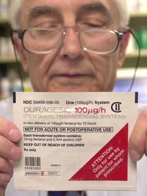 Out patient pharmacist Norman Folkman holds a pain patch at Temple University Hospital in Philadelphia. Prescriptions for the Duragesic patches and the reservoir of the powerful painkiller fentanyl have skyrocketed in the last decade, and with the drug's increased popularity have come more reports of abuse.