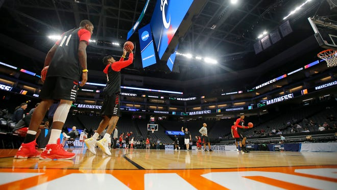 Cincinnati Bearcats forward Gary Clark (11) and Cincinnati Bearcats guard Jacob Evans (1) shoot 3-pointers during practice ahead of their first-round game against Kansas State in the NCAA Tournament, Thursday, March 16, 2017, at the Golden 1 Center in Sacramento, California.