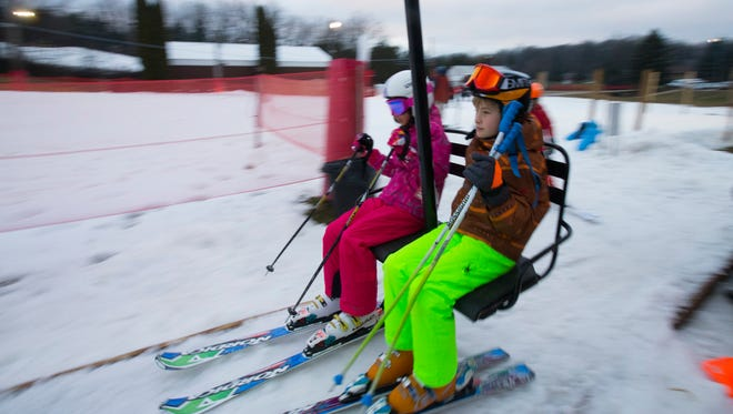 Skiers get on a chairlift at Little Switzerland Ski Area in Slinger.