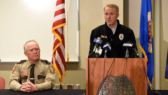 Aitkin County Sheriff Scott Turner listened while Drew Evans, superintendent of the Minnesota Bureau of Criminal Apprehension, said a suspect shot deputy Steven Martin Sandberg at St. Cloud Hospital.