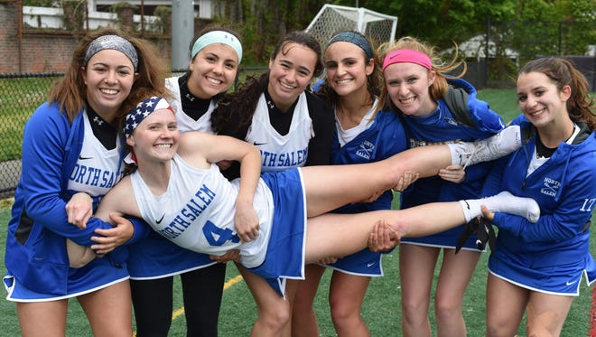 North Salem's Paige Werlau (4) with her teammates after scoring her 200th career goal in a 13-2 win at Ossining on Friday, May 6th, 2016.