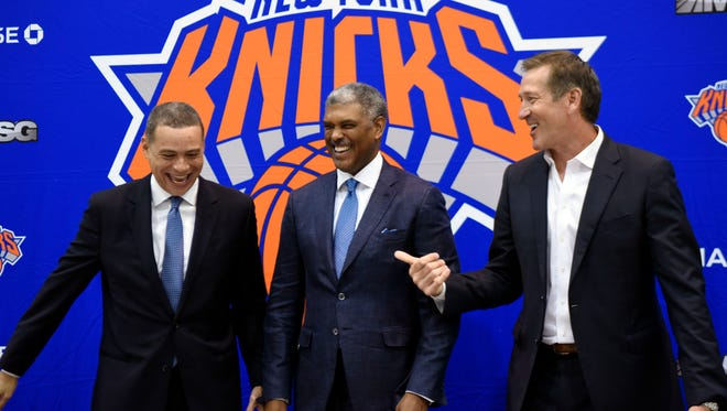(left to right) New York Knicks general manager Scott Perry, president Steve Mills, and head coach Jeff Hornacek joke around after holding a press conference introducing Perry as the new general manager at the Knicks Training Facility in Tarrytown, NY on Monday, July 17, 2017.