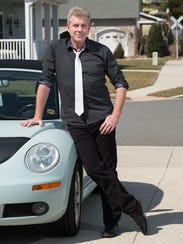 Michael Sprouse wears wear a black geo print shirt