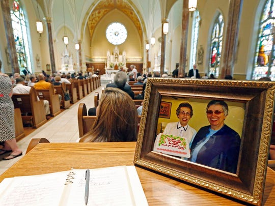 In this 2016 photo, a photograph showing Sisters Margaret Held, left, and Paula Merrill sits at the entrance to the Cathedral of St. Peter the Apostle in Jackson, Miss., where a memorial Mass was held.