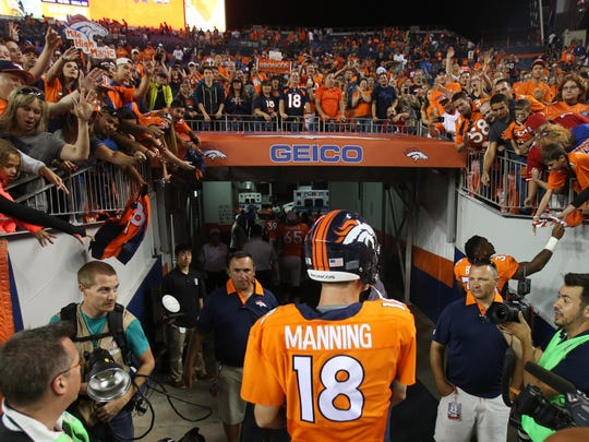 Aug 29, 2015; Denver, CO, USA; Denver Broncos quarterback Peyton Manning (18) walks off the field after the game against the San Francisco 49ers at Sports Authority Field at Mile High. The Broncos won 19-12. Mandatory Credit: Chris Humphreys-USA TODAY Sports