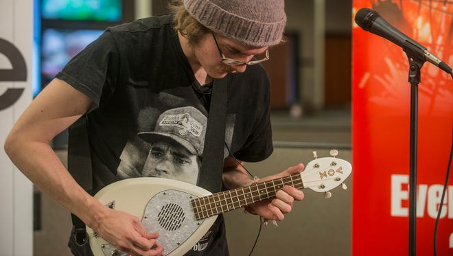 """Aaron Cummings of Greenville brings his own brand of """"Coyote Legs""""  imagination, singing and electric ukulele to our newsroom in this week's production of the Montgomery Advertiser LIVE! music series on Monday, April 11, 2016."""