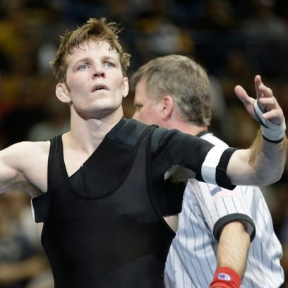 Iowa's Cory Clark celebrates after defeating South