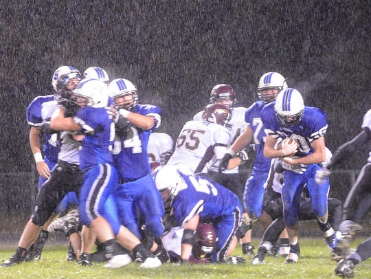 Heavy rains kept the passing game quiet during the