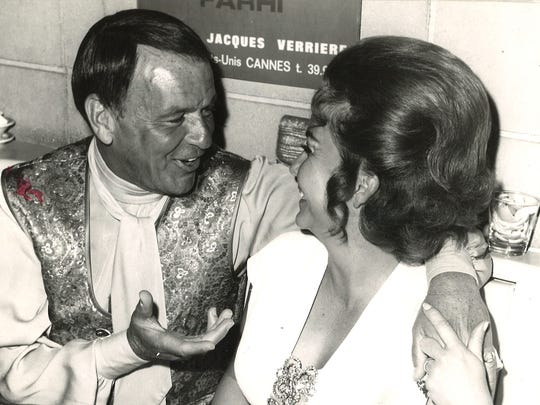 Frank Sinatra at Ruby's Dunes in Palm Springs. He's chatting with hostess  Beau Wheat.