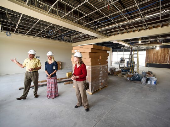 Bob Strack, CEO of Strack Companies, Sartell Mayor Sarah Jane Nicoll and Mary Degiovanni, Sartell city administrator, tour the senior center area Tuesday, June 27, in the new Sartell Community Center.