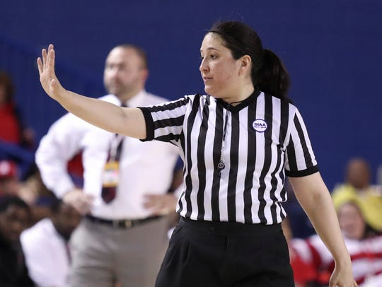 Kelly Callahan was the first woman referee to officiate a DIAA boys basketball tournament final in 2018.