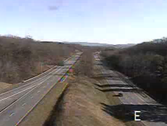Lanes of westbound I-64 are empty near the interchange