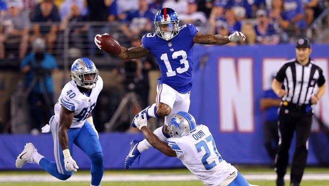 New York Giants wide receiver Odell Beckham Jr. is tackled by Detroit Lions safety Glover Quin in front of Detroit Lions linebacker Jarrad Davis during the second quarter at MetLife Stadium in East Rutherford, N.J.
