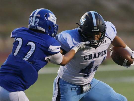 Chapin running back Matthew Zubiate fends off Bowie defender Ricardo Valles as he heads upfield Thursday.