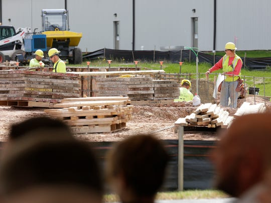 Workers work on building footings at MilliporeSigma during facility announcement Tuesday, September 5, 2017, in Sheboygan Falls, Wis.  The company said the addition to its Sheboygan Falls location is expected to add an additional 175 employees at that location.
