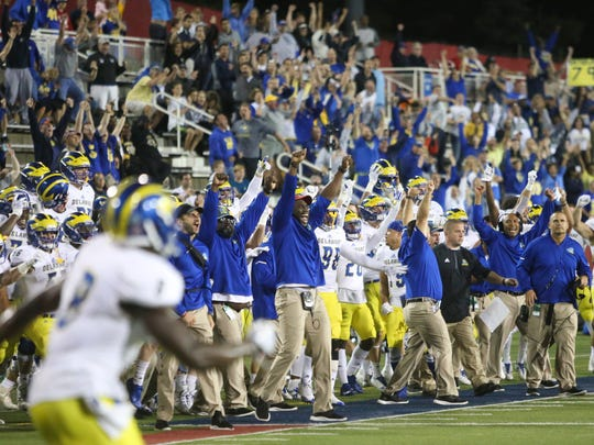 The Delaware bench and fans celebrate after stopping Stony Brook on fourth down in the final minute of the Blue Hens' 24-20 win at Lavalle Stadium Oct. 7.