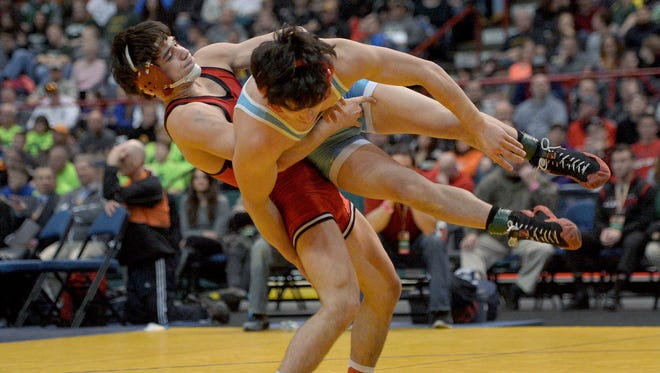 Hilton's Yianni Diakomihalis, left, wrestles against Fox Lane's Matthew Grippi in the finals of the 138-pound class (Division I) during the NYSPHSAA 2016 State Wrestling Championships held at the Times Union Center in Albany on Feb. 27, 2016.