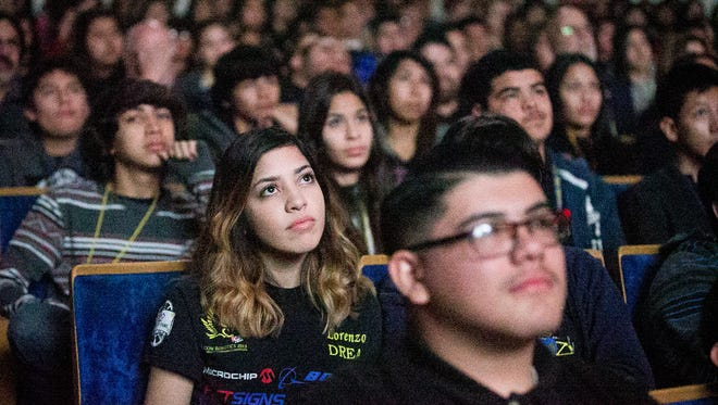 "Robotics team member Samantha Nieto, 16, watches the movie ""Spare Parts"" based on the Carl Hayden High winning robotics team at their auditorium in Phoenix on Tuesday, Jan. 6, 2014."