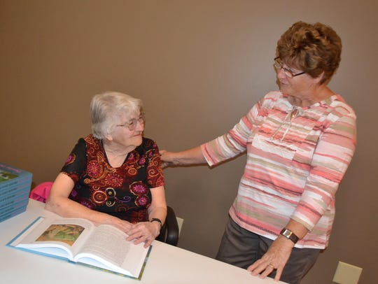 Dorothy Cox, left, talks with Sandy French during a