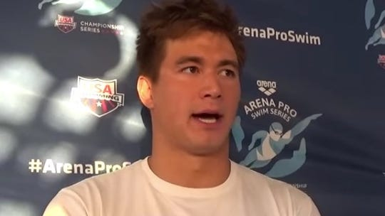 Nathan Adrian speaks during a press conference Thursday,