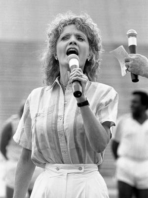 """TV star Florence Henderson is singing the National Anthem before the start of the fifth annual """"All American Country Games"""" Fan Fair charity event at Vanderbilt's Dudley Field June 11, 1986."""