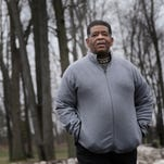 James Robertson, 57, goes for a walk near his apartment complex on Tuesday, January 26, 2016, in Troy, MI.