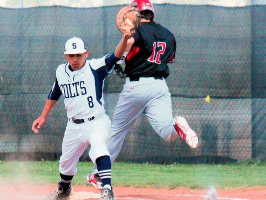 Danny Udero/Sun-News   Silver's Peter Alarid stretches as first base to make this play in time during a game against Hatch on Tuesday.