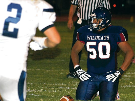 Former nose tackle Juan Carlos Wilson battled double and triple teams while anchoring the Deming Wildcat defensive line during the 2014 football season. He will play for the South squad during the North-South All-Star Football Game tonight in Albuquerque.