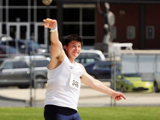 Chambersburg's Kelton Chastulik makes a throw to win the shot put with a mark of 48-7.75 on Saturday at the Mid Penn Conference Championships. Chastulik also won the discus with a throw of 151-1.