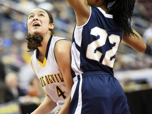 Greencastle's Jenay Faulkner (4) posts up against TaCari Talford (22) of Conrad Weiser during the District 3 Class AAA championship game. Faulkner scored 20 points to lead the Devils to a 57-52 win.